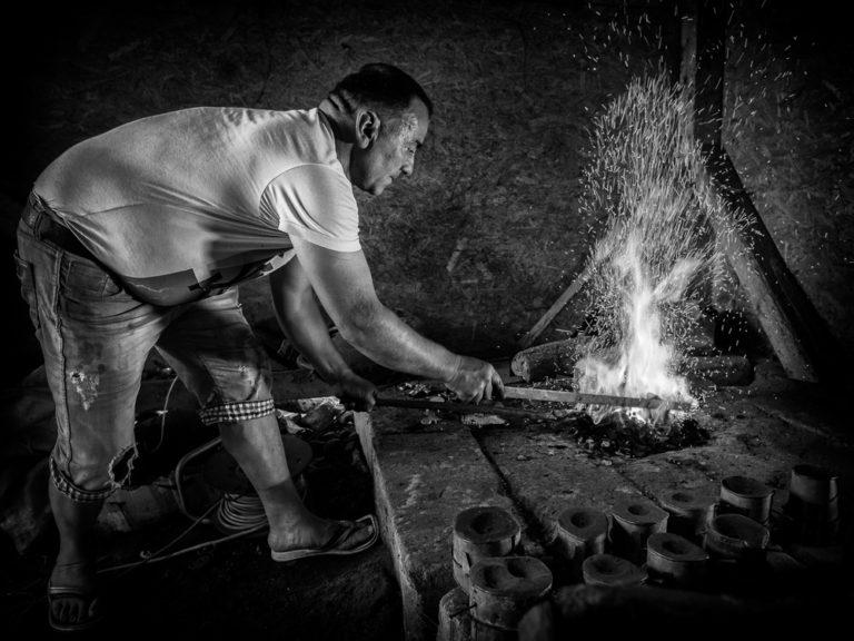Bellmaker stoking fire
